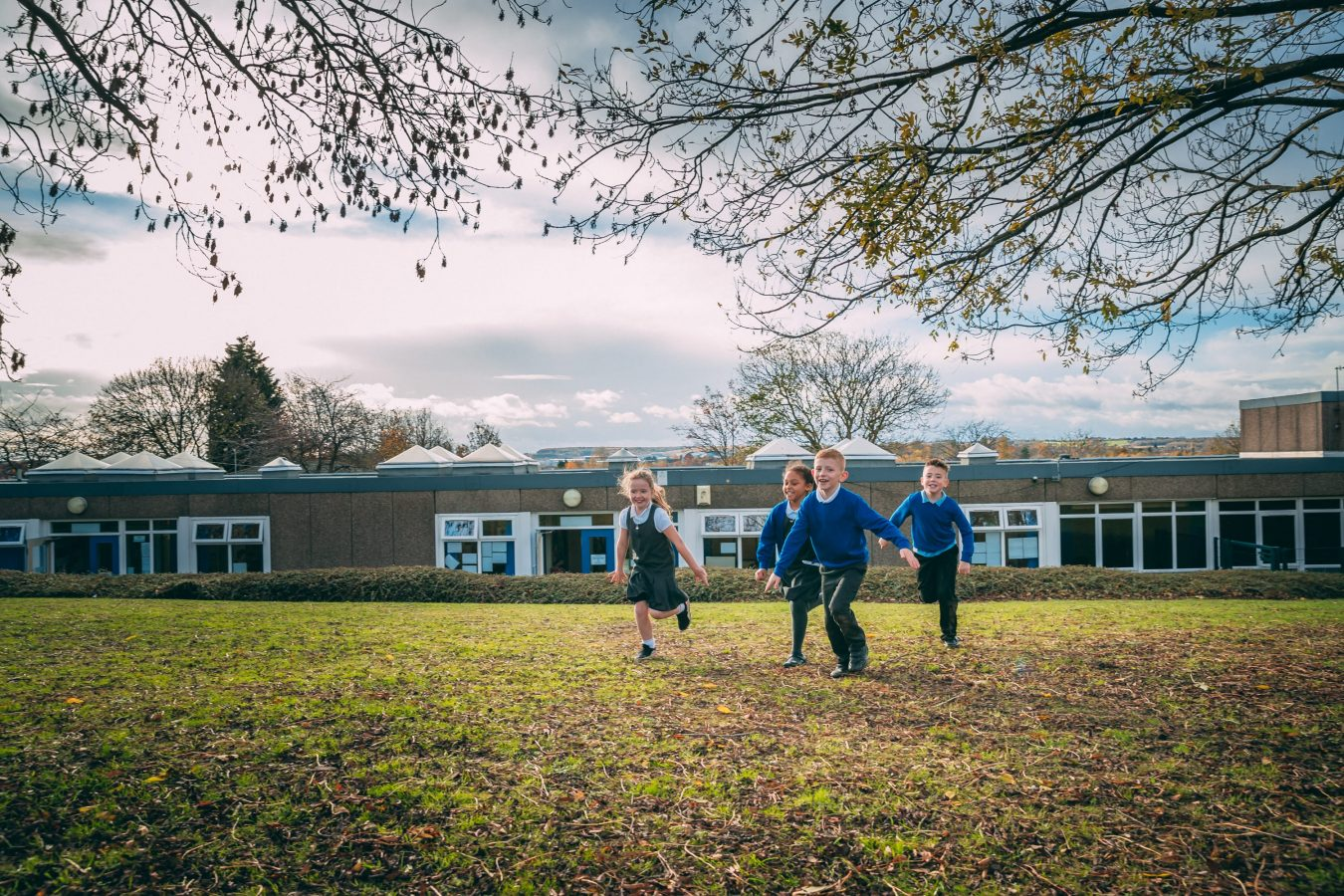 Students running in the school grounds